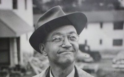 Alfred Weinstein, standing in front of the Holmes Street veterans apartments, faced down threats for forbidding racists and bigots as tenants.