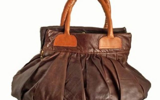 Arteeni.com sells items from 113 artists and designers, including a leather handbag from Havenstreet Studios.