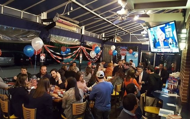 Young professionals watch the returns at the Election Night party held by American Jewish Committee Atlanta's ACCESS group at Jefe's Tacos & Tequila in Brookhaven. (Photo courtesy of Gabby Leon)