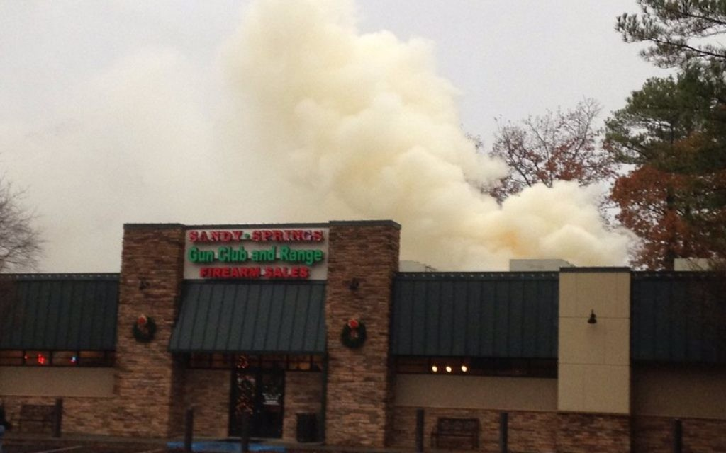 A fire burns through the roof of the Sandy Springs Gun Club and Range on Dec. 4. (Photo courtesy of the city of Sandy Springs)