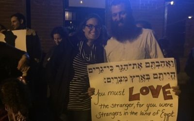 #JewishResistance protesters Kelly and Drew Cohen hold a sign expressing support for love and acceptance.