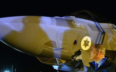 One of the first two F-35 Adir jets sits at Nevatim Air Force Base behind Prime Minister Benjamin Netanyahu on Dec. 12. (Photo by Kobi Gideon, Government Press Office)