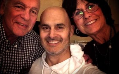 Scott Selig, shown with parents Steve and Janet Selig, battled cancer for a year but lost the fight at age 47.