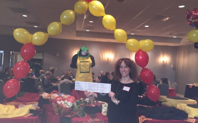 "Shauna Horvath displays her ""game on"" mah jongg card at the Breman Jewish Home benefit at Temple Sinai on Jan. 30."