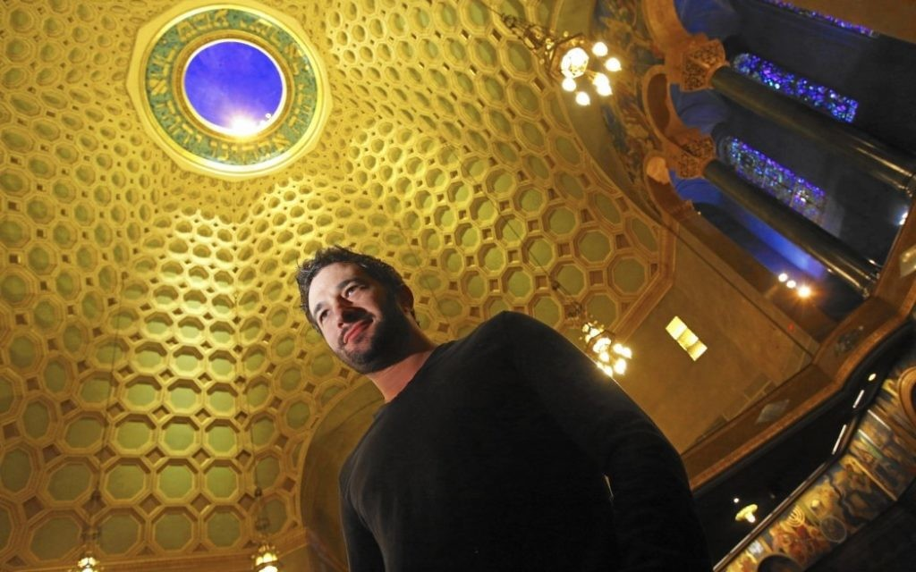"""Aaron Wolf, the filmmaker behind """"Restoring Tomorrow"""" (screening Jan. 27 and Feb. 5), stands beneath the 100-foot dome of Wilshire Boulevard Temple."""