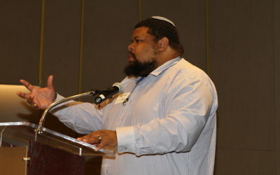 Michael Twitty speaks at a Repair the World dinner in Atlanta in November.