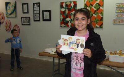 Amelia Andrews shows the drawing that earned her runner-up recognition among 10- to 12-year-olds.