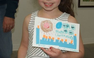For Evie Carmel, a runner-up in the 6-and-under category, Chanukah is too festive for only nine candles.