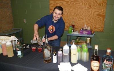 Mixologist Robbie Medwed takes on the role of bartender and crafts an array of locally sourced cocktails.