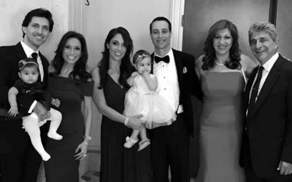 The Nooromid family includes (from left) Bobby Nooromid holding daughter Bella, Naz Shaban Nooromid, Rachel Nooromid Levin holding daughter Maya, Jason Levin, Safa Aghajani Nooromid and Sharokh Nooromid.