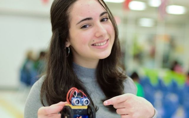 TDSA eighth-grader Shayna Winick shows the robotics project that won her a second-place ribbon.
