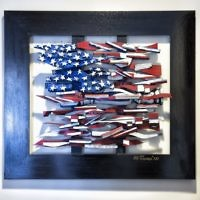 Ab the Flagman goes red, white and blue in this wood sculpture.