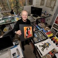 Paul Muldawer makes good use of his lower-level workshop, where he stores no fewer than 13,000 photos for future projects.