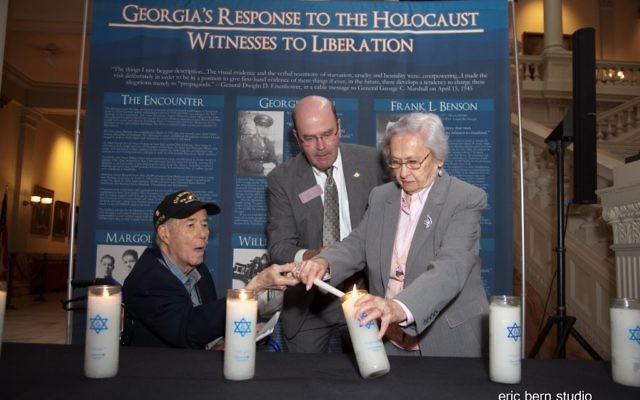 At the Aug. 17, 2015, Days of Remembrance ceremony held at the Georgia Capitol, liberator Howard Margol and Holocaust survivor Elizabeth Lefkovits light a memorial candle with the help of state Rep. Bruce Broadrick (R-Dalton). (Photo by Eric Bern)