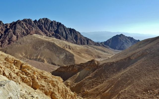 Could the black mountain to the right, west of Eilat, be the biblical Mount Sinai?