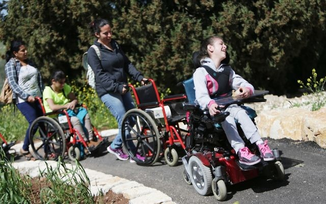 Children with disabilities explore a LOTEM hiking trail.