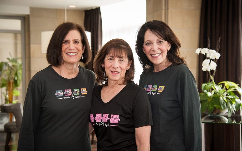 Photo by Vosamo Photography (From left) Debbi Chartash, Rina Wolfe and Melody Maziar pose with their Angels 4 Angels T-shirts while participating in the 3-Day 60 Mile Walk for Breast Cancer.
