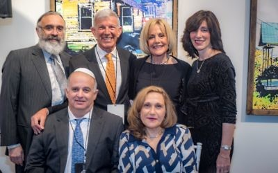 Rabbi Yossi New and Dassie New flank honorees Michael and Rita LeVine (standing) and Ian and Yaarit Silverstone. --- Photos by J. Braxton Photography