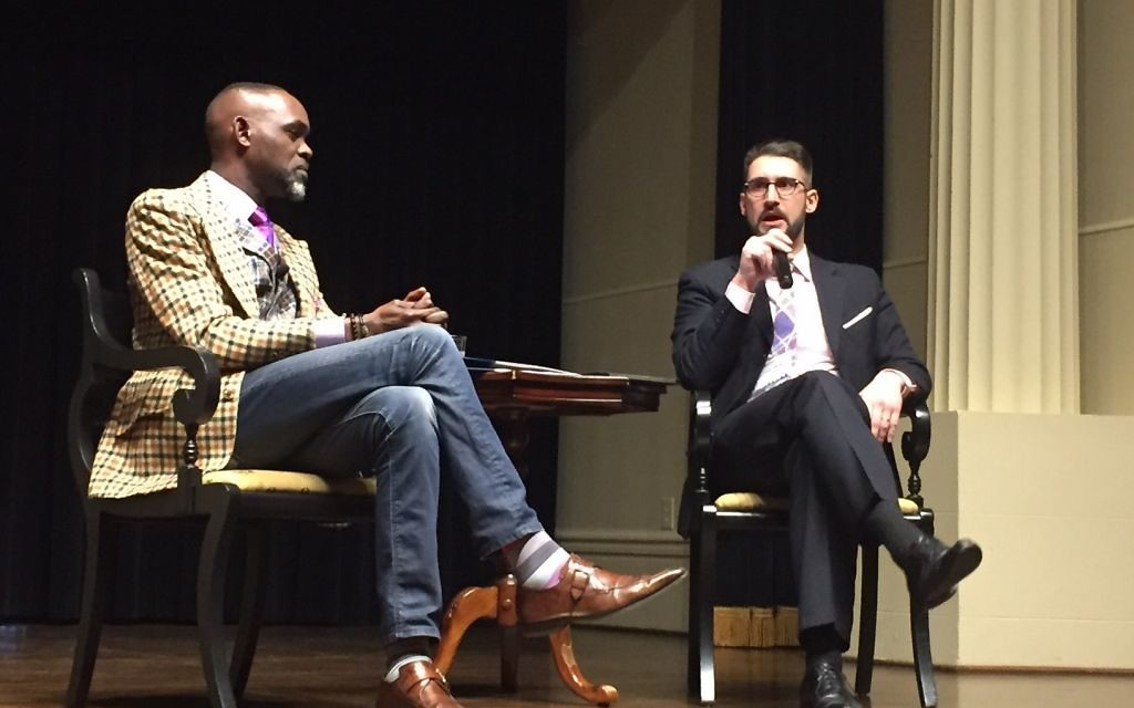 National Center for Civil and Human Rights CEO Derreck Kayongo (left) and Associate Director and Harold J. Berman Fellow in Law and Religion Silas Allard discuss how the legal power to protect immigrants' rights applies to the marketplace.