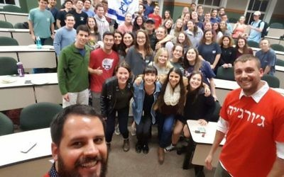 Israeli soldiers Ilan and Marc (in front) pose with most of the students who attended their StandWithUs talk Feb. 21.