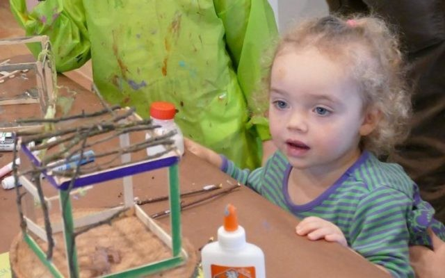 Children check out their handiwork in a mini-treehouse craft project at Intown Jewish Preschool's Tu B'Shevat event Sunday, Feb. 5.