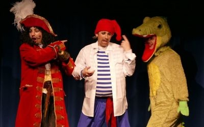 The Crocodile (Annalise Hardy) sneaks up on Captain Hook (Darren Rosing) and Smee (Matthew Szabo).
