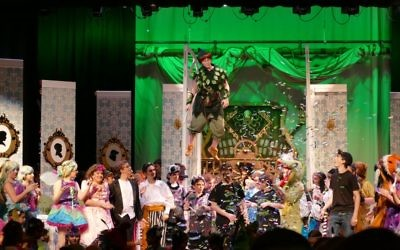 Peter Pan (Grace Ross) soars above the cast during the post-show ovations.
