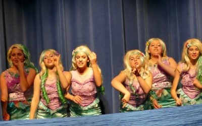The mermaids show their fondness for Peter Pan.