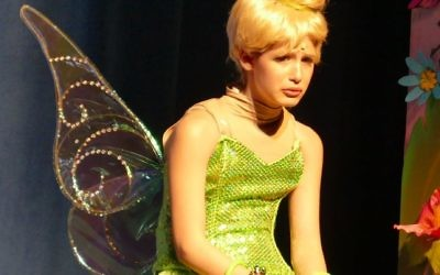 Tinker Bell (Brooke Ross) is sad at being banished for trying to get Wendy killed.