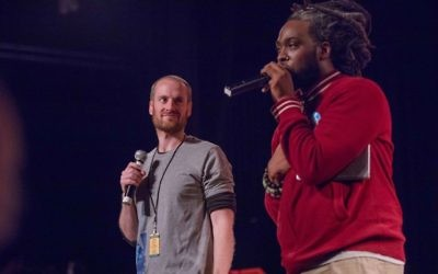 "AJMF Executive Director Russell Gottschalk and local hip-hop artist Adan Bean introduce the live cover of the Beastie Boys' album ""Licensed to Ill."""