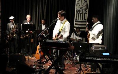 AJMF songwriting commission winner Nick Edelstein performs at Eddie's Attic during international night.