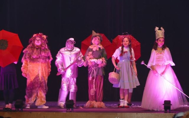 Glinda (sixth-grader Eva Beresin) rescues Dorothy (Shiraz Agichtein), the Scarecrow (sixth-grader Jordan Joel), the Tinman (sixth-grader Dov Karlin) and the Lion (sixth-grader Miriam Burmenko) from a field of poppies.