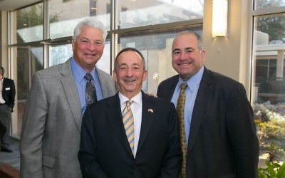 Ahavath Achim board member Richard Swerdlin (left) and synagogue President Rob Wildstein flank honoree Larry Gold.