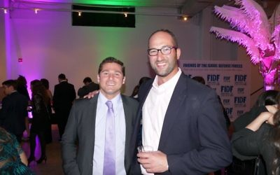 Photo by David R. Cohen  Kevin Rabinowitz and David Tillem catch up at casino night.