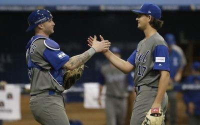 Israel pitcher Dean Kremer, right, celebrates his team's victory with catcher Nick Rickles against Taiwan after the first round game of the World Baseball Classic at Gocheok Sky Dome in Seoul, South Korea, Tuesday, March 7, 2017. (AP/Ahn Young-joon)
