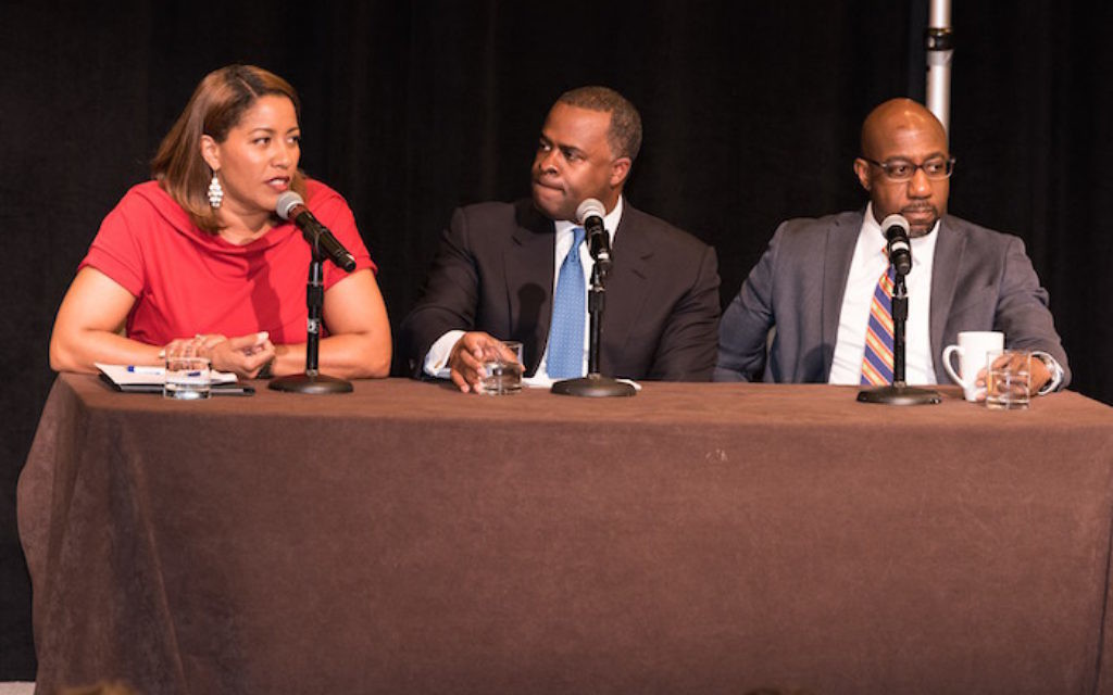 During an interfaith discussion at the CCAR convention in Atlanta, Mayor Kasim Reed is flanked by two pastors from Ebenezer Baptist Church, the Rev. Natosha Reid Rice and the Rev. Raphael Warnock