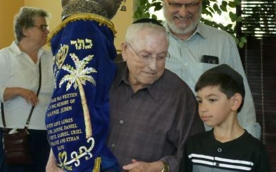 The Torah ceremony at Chabad of Cobb unites the generations.