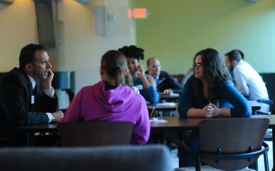 Rabbi David Spinrad engages with one small group of diners to discuss diversity within different religions' food and music.