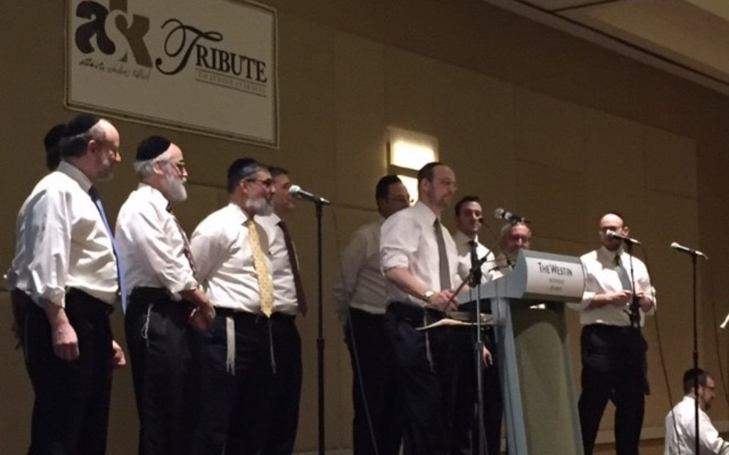 "Atlanta Scholars Kollel rabbis perform the chorus of ""Teach Us a Song"" to the tune of Billy Joel's ""Piano Man."""