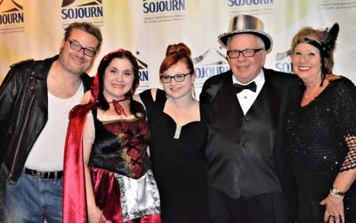 Three generations of Bernsteins attend Purim off Ponce: (from left) Rabbi Michael Bernstein; his wife, Tracie; their daughter, Ayelet; and his parents, Phil and Anne.