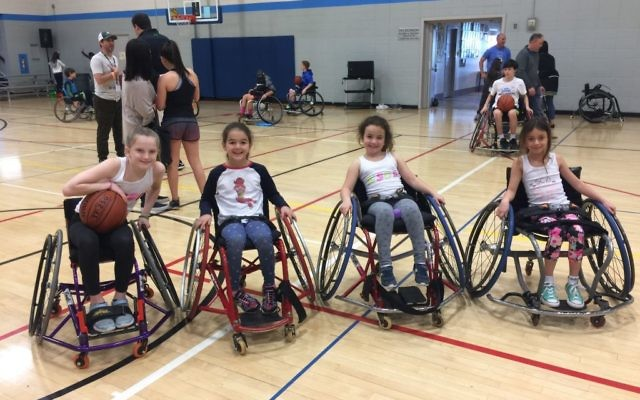 Able-bodied girls get to try out wheelchair basketball at the Marcus JCC Feb. 26.