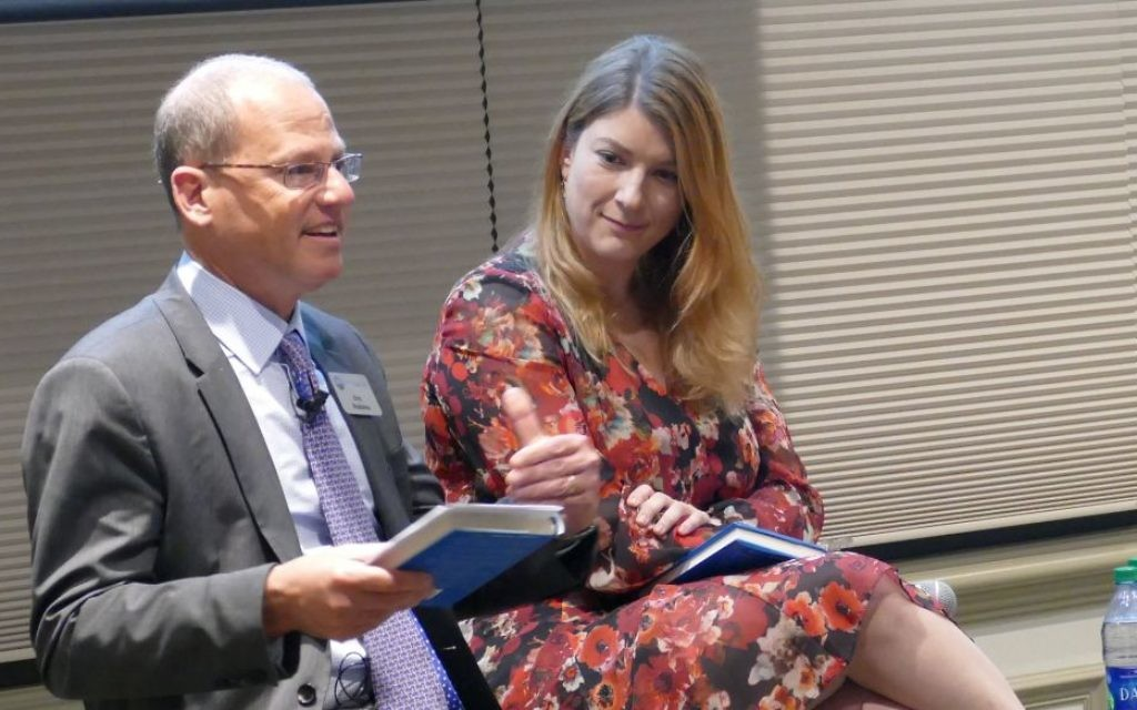 """Federation CEO Eric Robbins talks about the ways Jewish Atlanta fulfills the message of Edgar Bronfman's """"Why Be Jewish"""" as author Ruth Andrew Ellenson listens March 9."""