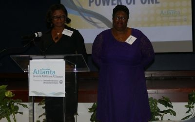 LaWanda Crawl (left) recognizes Adriane Hill on behalf of JF&CS.