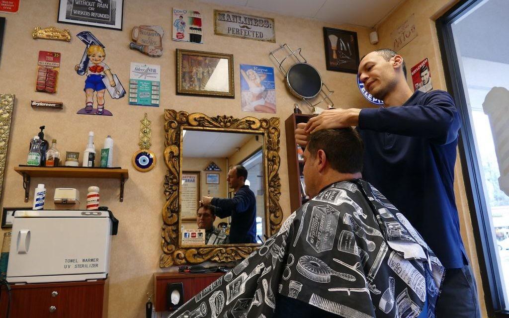 Yury Abramov honed his skills in New York before opening Vintage Barbershop in Sandy Springs in 2012.