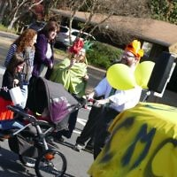 Chaya Mushka Children's House has a prominent, yellow presence at the Purim Parade on March 5, 2017.