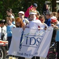 Torah Day School students show their school pride at the 2017 Purim Parade.