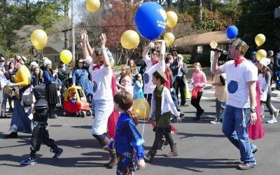 Atlanta Jewish Academy representatives dance their way down LaVista.