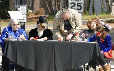 The judges keep a close eye on the passing entertainment.