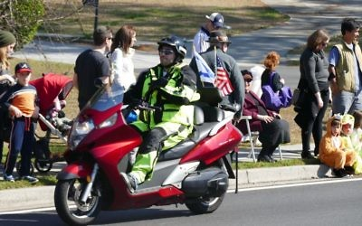 Motorcycles at the annual Toco Hills Purim Parade are a bit more controlled and a lot more road-ready than a dirt bike decades ago.