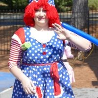 Who's that making balloon animals during the parade and carnival? It's Raggedy Ann.